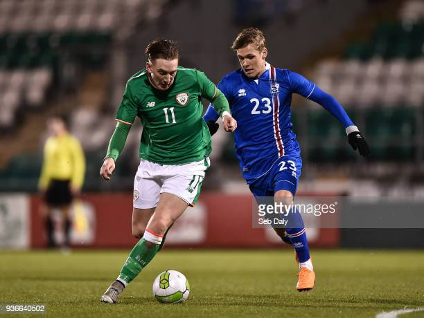 Dublin Ireland 22 March 2018 Ronan Curtis of Republic of Ireland in action against Arnor Sigurdsson of Iceland during the U21 International Friendly...
