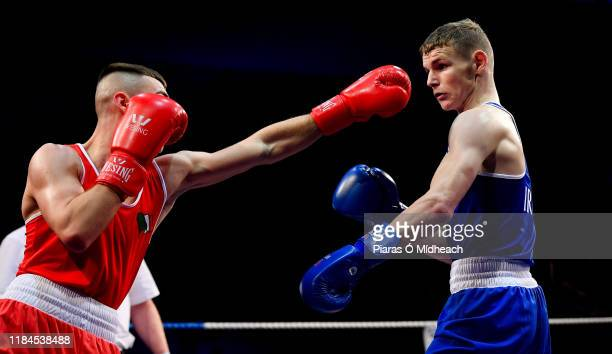 Dublin Ireland 22 November 2019 Brandon McCarthy of St Michael's Athy Co Kildare right in action against Barry McReynolds of Holy Trinity Co Antrim...