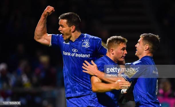 Dublin Ireland 22 September 2018 Jordan Larmour of Leinster celebrates with teammates Jonathan Sexton left and Luke McGrath after scoring his side's...