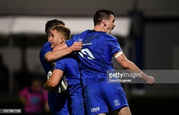 Dublin Ireland 22 September 2018 Jordan Larmour of Leinster celebrates with team mates Jonathan Sexton right and Luke McGrath after scoring his...