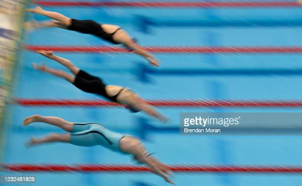 Dublin , Ireland - 23 April 2021; Swimmers, from top, Victoria Catterson of Ards SC, Ellie McKibben of Ards AC and Naomi Trait of Kilkenny SC compete...