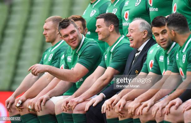 Dublin Ireland 23 February 2018 Ireland players Peter O'Mahony 2nd left and Jonathan Sexton with IRFU President Phil Orr during the taking of their...