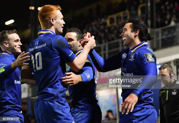 Dublin Ireland 23 February 2018 James Lowe of Leinster celebrates with teammate Ciarán Frawley and Nick McCarthy left after scoring their side's...