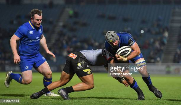Dublin Ireland 23 February 2018 Mick Kearney of Leinster is tackled by Berton Klaasen of Southern Kings during the Guinness PRO14 Round 16 match...