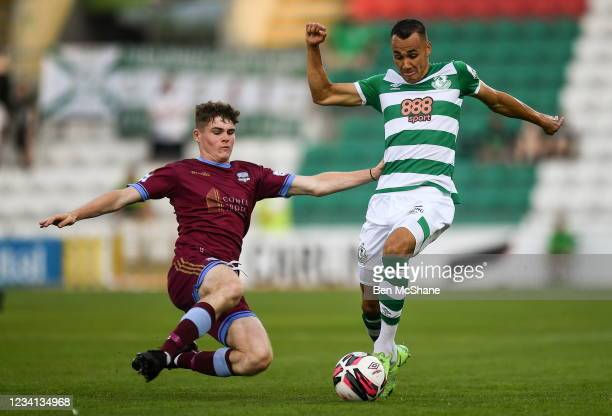 Dublin , Ireland - 23 July 2021; Graham Burke of Shamrock Rovers is tackled by Alex Murphy of Galway United during the FAI Cup first round match...