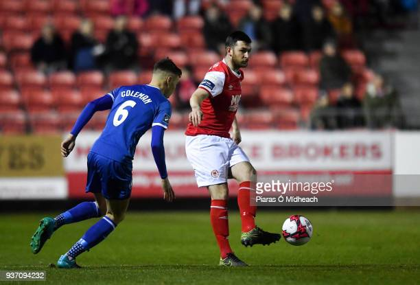 Dublin Ireland 23 March 2018 Ryan Brennan of St Patrick's Athletic in action against Cian Coleman of Limerick during the SSE Airtricity League...