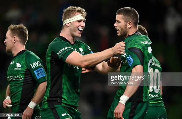 Dublin , Ireland - 23 October 2021; Diarmuid Kilgallen of Connacht celebrates with team-mate Niall Murray, left, after scoring their side's fourth...