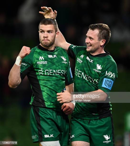 Dublin , Ireland - 23 October 2021; Diarmuid Kilgallen of Connacht celebrates with team-mate Jack Carty, right, after scoring their side's fourth try...