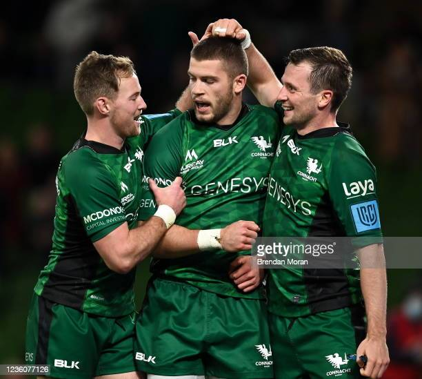 Dublin , Ireland - 23 October 2021; Diarmuid Kilgallen of Connacht celebrates with team-mates Kieron Marmion, left, and Jack Carty, right, after...