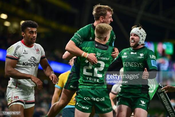 Dublin , Ireland - 23 October 2021; John Porch of Connacht celebrates with team-mates Conor Fitzgerald and Mack Hansen after scoring their side's...