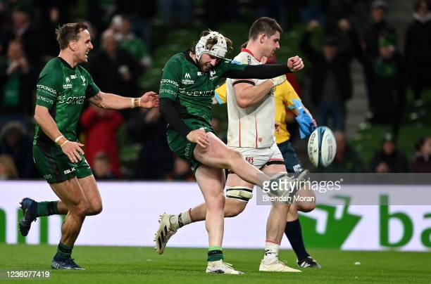 Dublin , Ireland - 23 October 2021; Mack Hansen of Connacht celebrates with team-mate John Porch after scoring their side's fifth try during the...