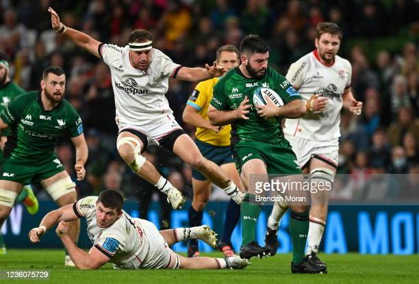 Dublin , Ireland - 23 October 2021; Matthew Burke of Connacht beats the tackles of Rob Herring and Nick Timoney of Ulster during the United Rugby...