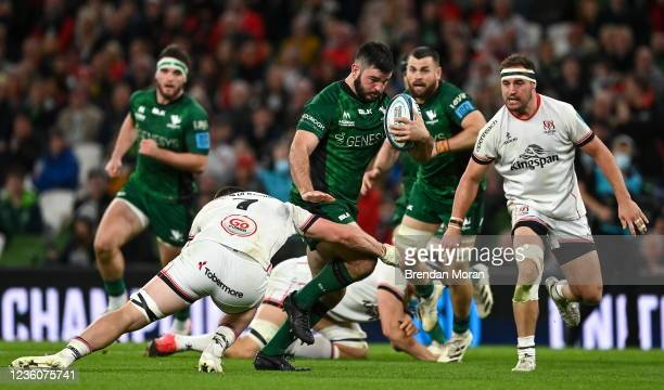 Dublin , Ireland - 23 October 2021; Matthew Burke of Connacht is tackled by Nick Timoney of Ulster during the United Rugby Championship match between...