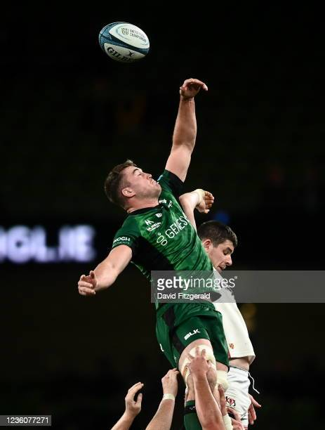 Dublin , Ireland - 23 October 2021; Oisín Dowling of Connacht wins possession ahead of Nick Timoney of Ulster during the United Rugby Championship...