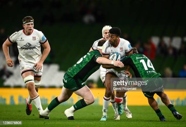 Dublin , Ireland - 23 October 2021; Robert Baloucoune of Ulster is tackled by Eoghan Masterson, left, and John Porch of Connacht during the United...