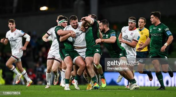 Dublin , Ireland - 23 October 2021; Stuart McCloskey of Ulster is tackled by Tom Daly and Jack Carty of Connacht during the United Rugby Championship...