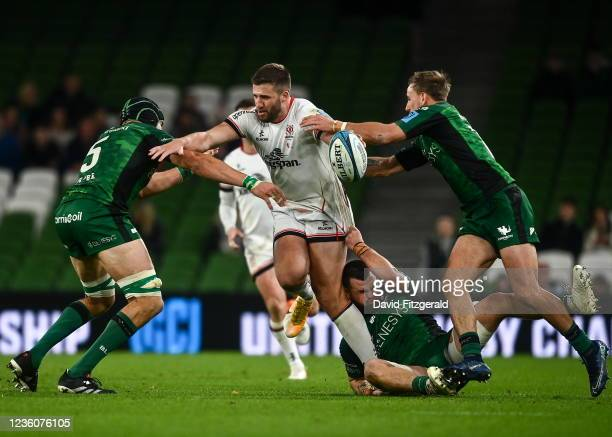 Dublin , Ireland - 23 October 2021; Stuart McCloskey of Ulster is tackled by Connacht players, from left, Ultan Dillane, Conor Oliver and John Porch...