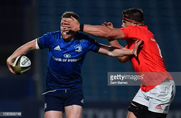 Dublin , Ireland - 24 April 2021; Rory O'Loughlin of Leinster is tackled by CJ Stander of Munster during the Guinness PRO14 Rainbow Cup match between...