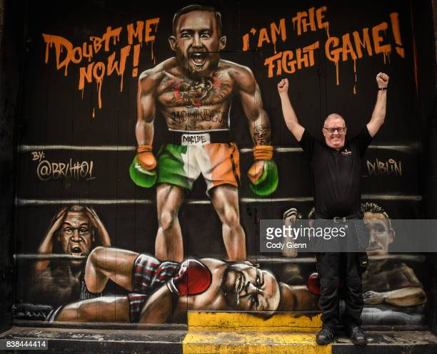 Dublin Ireland 24 August 2017 Damien Walsh from Ashington Dublin pictured in front of a mural of Conor McGregor and Floyd Mayweather outside Sin...