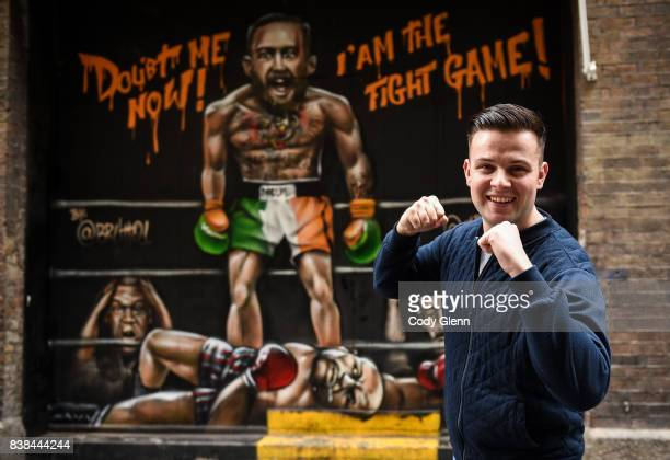 Dublin Ireland 24 August 2017 Oisín Hand a longtime Conor McGregor supporter from Balbriggan Dublin pictured in front of a mural of Conor McGregor...