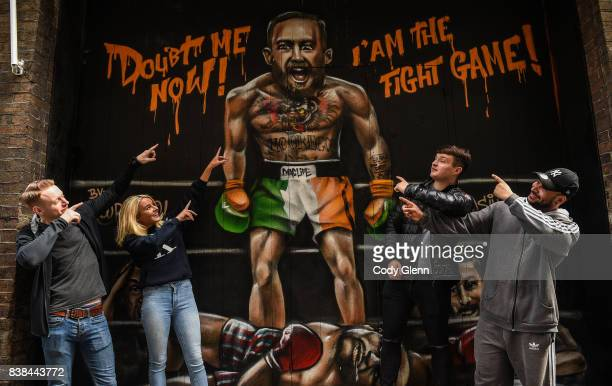 Dublin Ireland 24 August 2017 Sin Nightclub employees from left Ryan Fox Amy Rufli Thomas Harmon and Shaq Eustace pictured in front of a mural of...