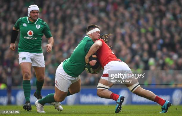 Dublin Ireland 24 February 2018 Andrew Porter of Ireland is tackled by Josh Navidi of Wales during the NatWest Six Nations Rugby Championship match...