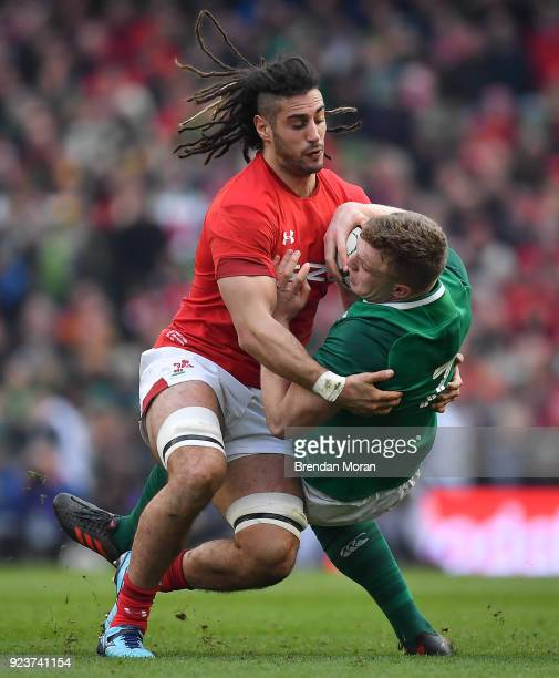 Dublin Ireland 24 February 2018 Dan Leavy of Ireland is tackled by Josh Navidi of Wales during the NatWest Six Nations Rugby Championship match...