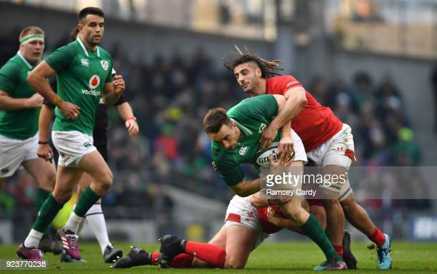 Dublin Ireland 24 February 2018 Jack Conan of Ireland is tackled by Josh Navidi of Wales during the NatWest Six Nations Rugby Championship match...