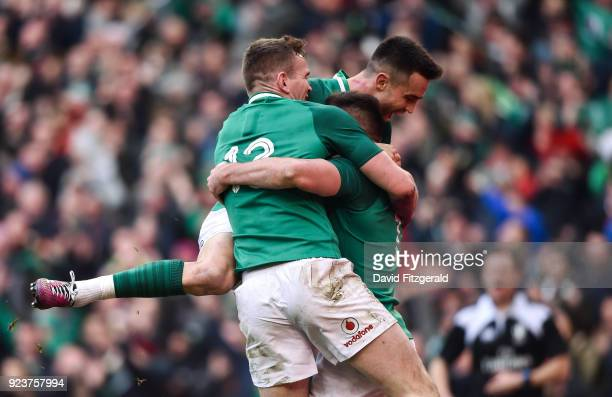 Dublin Ireland 24 February 2018 Jacob Stockdale centre of Ireland is congratulated by team mates Conor Murray behind and Chris Farrell after scoring...