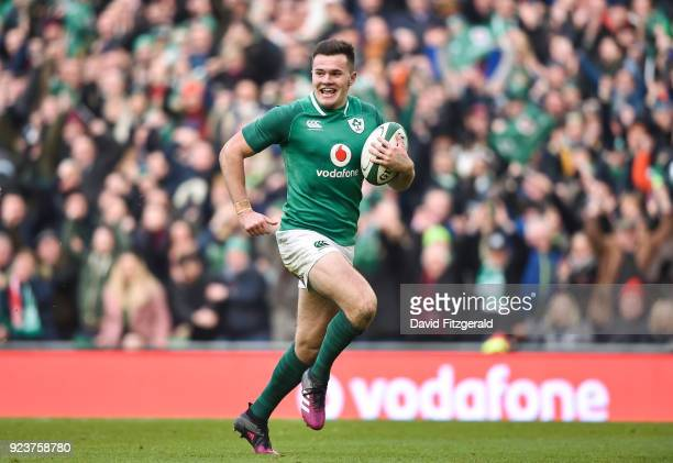 Dublin Ireland 24 February 2018 Jacob Stockdale of Ireland on his way to scoring his side's fifth try during the NatWest Six Nations Rugby...