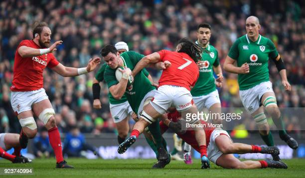Dublin Ireland 24 February 2018 James Ryan of Ireland is tackled by Ross Moriarty and Josh Navidi of Wales during the NatWest Six Nations Rugby...