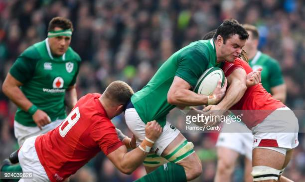 Dublin Ireland 24 February 2018 James Ryan of Ireland is tackled by Ross Moriarty left and Josh Navidi of Wales during the NatWest Six Nations Rugby...