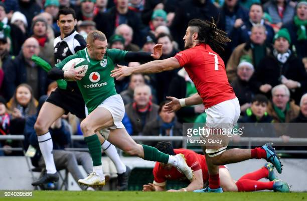 Dublin Ireland 24 February 2018 Keith Earls of Ireland is tackled by Josh Navidi of Wales during the NatWest Six Nations Rugby Championship match...