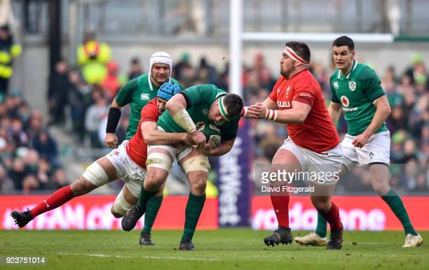Dublin Ireland 24 February 2018 Peter O'Mahony of Ireland is tackled by Hadleigh Parkes of Wales during the NatWest Six Nations Rugby Championship...