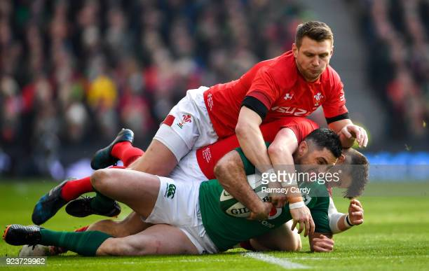 Dublin , Ireland - 24 February 2018; Rob Kearney of Ireland is tackled by Dan Biggar, above, and Steff Evans of Wales during the NatWest Six Nations...
