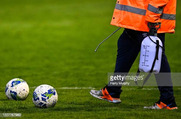 Dublin , Ireland - 24 July 2020; A groundsman disinfectsa ball during the club friendly match between Shelbourne and Linfield at Tolka Park in...