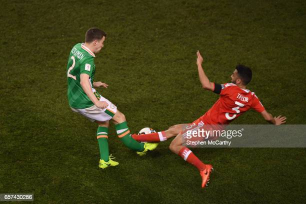 Dublin Ireland 24 March 2017 Seamus Coleman of Republic of Ireland is tackled by Neil Taylor of Wales during the FIFA World Cup Qualifier Group D...