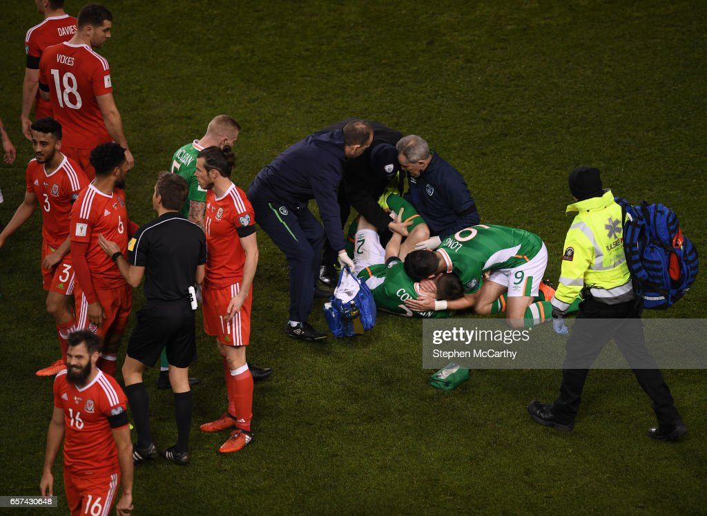Dublin , Ireland - 24 March 2017; Seamus Coleman of Republic of Ireland is consoled by team mate Shane Long as he is attended to following a tackle from Neil Taylor of Wales during the FIFA World Cup Qualifier Group D match between Republic of Ireland and Wales at the Aviva Stadium in Dublin.