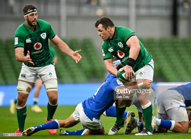 Dublin , Ireland - 24 October 2020; Cian Healy of Ireland looks to off load to team-mate Caelan Doris as he is tackled by Marcello Violi of Italy...