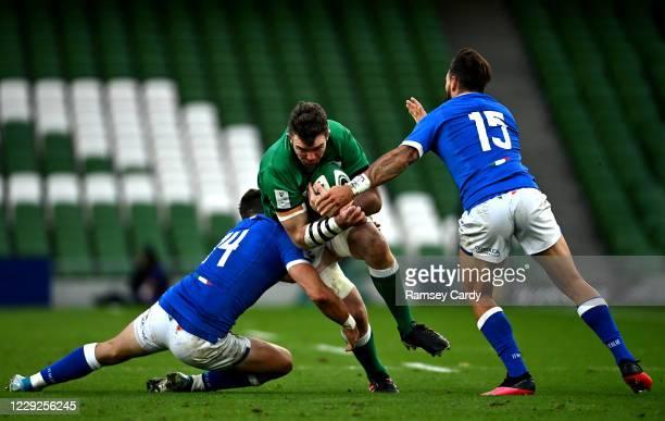 Dublin , Ireland - 24 October 2020; Peter O'Mahony of Ireland is tackled by Edoardo Padovani, left, and Jayden Hayward of Italy during the Guinness...