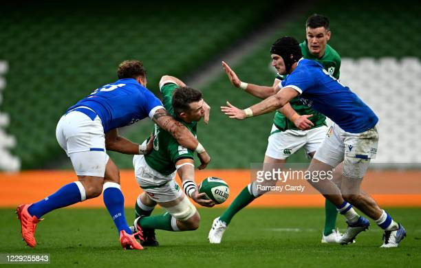 Dublin , Ireland - 24 October 2020; Peter O'Mahony of Ireland offloads in the tackle by Federico Mori of Italy during the Guinness Six Nations Rugby...
