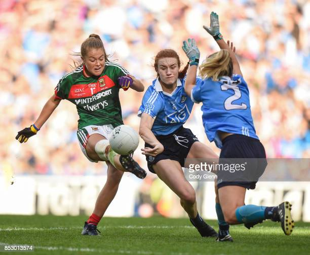 Dublin Ireland 24 September 2017 Sarah Rowe of Mayo has her shot blocked by Lauren Magee and Martha Byrne of Dublin during the TG4 Ladies Football...