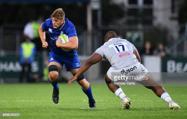 Dublin Ireland 25 August 2017 Jordi Murphy of Leinster is tackled by Beno Obano of Bath during the Bank of Ireland preseason friendly match between...