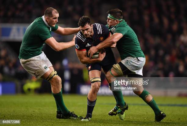 Dublin Ireland 25 February 2017 Charles Ollivon of France is tackled by Devin Toner left and CJ Stander of Ireland during the RBS Six Nations Rugby...