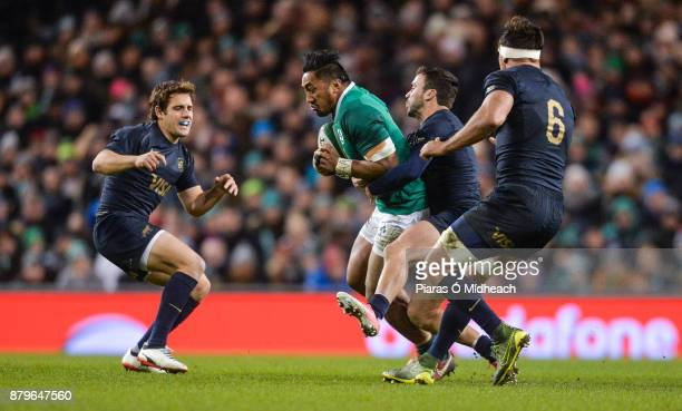Dublin Ireland 25 November 2017 Bundee Aki of Ireland in action against Argentina's from left Nicolas Sanchez Martin Landajo and Pablo Matera during...
