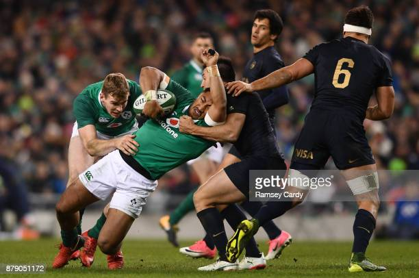 Dublin Ireland 25 November 2017 Bundee Aki of Ireland is tackled by Santiago Gonzalez Iglesias of Argentina during the Guinness Series International...