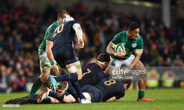 Dublin Ireland 25 November 2017 Bundee Aki of Ireland is tackled by Marcos Kremer left and Tomas Lezana of Argentina during the Guinness Series...