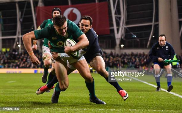 Dublin Ireland 25 November 2017 Jacob Stockdale of Ireland dives over to score his side's second try despite the tackle of Joaquin Tuculet of...