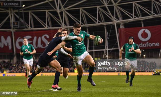 Dublin Ireland 25 November 2017 Jacob Stockdale of Ireland on his way to scoring his side's second try despite the tackle of Joaquin Tuculet of...