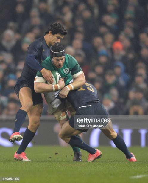 Dublin Ireland 25 November 2017 Sean O'Brien of Ireland in action against Matias Moroni left and Joaquin Tuculet of Argentina during the Guinness...